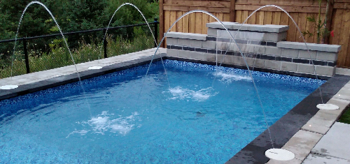 Seaway inground swimming pool installed with multiple deckjets