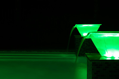 Green light-up water bowl landscape design by Seaway Pools